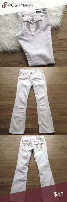 """Miss Me Boot Cut White Jeans Sz 28 Add these awesome white Miss Me jeans to your summer wardrobe!  Back pockets are embellished with silver wings and rhinestones.   Sz 28 Woman's.  Measurements: Waist (lying flat) - 15"""" Inseam - 32"""" Length - 41""""  Thank you for shopping in my closet! Miss Me Jeans Boot Cut"""