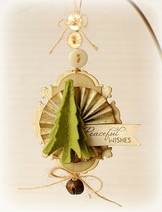 A beautiful tag with die cuts, love the buttons and the dimension...could be an ornament!