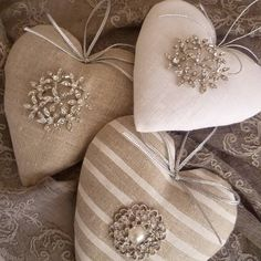 Linen hearts with brooches