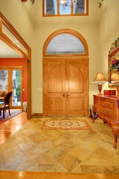Traditional Entryway with Carpet, limestone tile floors, High ceiling