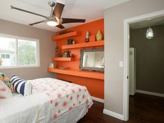 This neutral bedroom is brought to life with the modern orange accent wall that has floating shelves Orange Accent Walls, Striped Accent Walls, Bedroom Red, Home Decor Bedroom, Modern Bedroom, Construction Bedroom, Bathroom Accent Wall, Transitional Living Rooms, Interior Decorating