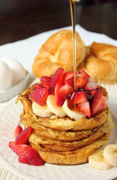 Croissant French Toast with strawberries and bananas is the perfect breakfast!