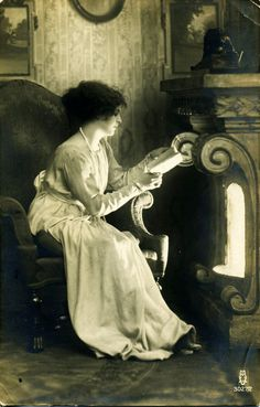 """Vintage photograph. Reading by firelight. """"If I read a book and it makes my whole body so cold no fire can ever warm me, I know that is poetry."""" — Emily Dickinson"""