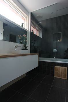 The new upstairs ensuite bathroom. Striking contrast between the charcoal tiles, white joinery & plywood vanity top.