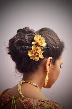 Indian bride's reception hairstyle by Swank Studio. Bridal updo. Hair Accessories. Tamil bride. Telugu bride. Kannada bride. Hindu bride. Malayalee bride. Find us at https://www.facebook.com/SwankStudioBangalore