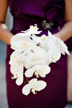Fabulous orchid bouquet for the maid of honor in this bridal party. Stunning against the deep purple dress. Photo: The Youngrens