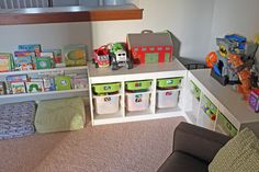 Love this nook for books and toys in a playroom.