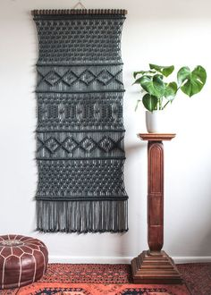 This macrame wall hanging is hand-knotted using 100% cotton cord (twisted, 4.5mm) in charcoal with a bamboo supporting rod. Approx Dimensions > Width: 75cm / 29.5 inches Length: 171cm / 67 inches