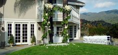 Palms trees transformed into a ceremonial structure with #vines and #whiteroses