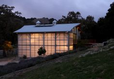 100 yr old barn clad w/ translucent glass panels; Santa Ynez Barn by Carver + Schicketanz