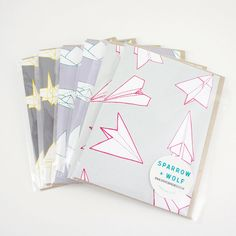 Origami paper planes and boats and cranes greetings cards