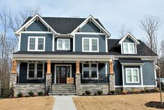 <ul><li>A front porch with timber supports and trimmed with stone greets you to this Craftsman house plan with 4 or 5 beds.</li><li>The foyer is flanked by the study and dining rooms, the latter connected to the kitchen giving the home a circular flow.</li><li>The great room has a fireplace and access to the rear screened porch and is open to the kitchen.</li><li>The kitchen island has counter seating...