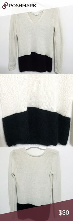 Club Monaco White & Black Rabbit Hair Sweater Pre-loved in excellent condition. Women's size Small. Only worn a handful of times and will look lime new once washed! This Club Monaco White & Black Colorblock Rabbit Hair & Cashmere Long Sweater is so soft and cozy! The white part is 35% Viscose 28% Lambswool 23% Nylon 8% Angora Rabbit Hair & 6% Cashmere. The black part is 67% Angora Rabbit Hair and 33% Nylon. Definitely a luxurious piece to add to your wardrobe! Super cute pair with leggings…