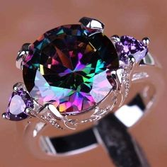 'Huge Stunning Mystic Topaz Ring Size 7' is going up for auction at  1pm Fri, Sep 21 with a starting bid of $20.