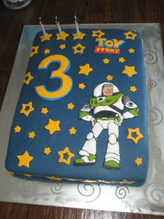 Buzz Lightyear Cake - A cake I made for my friend's son's third birthday. He loves Toy Story. Buzz Lightyear is a royal icing transfer - my first time trying that and I must say I enjoyed it although I need a bit more practice. The rest of the decorations are made of fondant. Thanks for looking :)