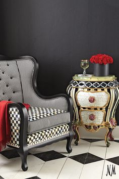 Traditional with a twist by MacKenzie-Childs. Add a whimsical touch to any room with striped and checkered chests and chairs.