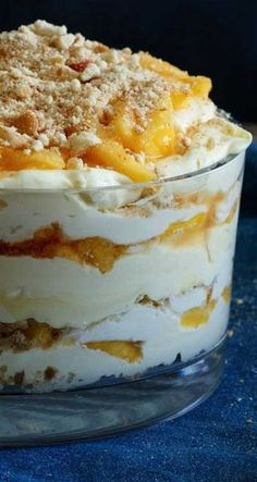 Delicious Recipes - Peach Vanilla Cheesecake Trifle - Shared Appetite Quick and easy snacks and desserts are best, aren't they? This Peach Vanilla Cheesecake Trifle is simple to whip up and will be sure to impress all your family and friends! Layered Desserts, Easy Desserts, Delicious Desserts, Yummy Food, Easy Snacks, Gourmet Desserts, Brownie Desserts, Trifle Desserts, Dessert Recipes