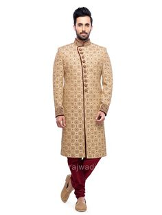 Glowing golden color brocade sherwani enriched with shiny cutdana, stone, pearl and zardozi work will definitely touch your soul. Comes with maroon color bottom.