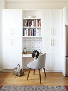 Eric starts his mornings at the built-in desk (custom from 3 Dot Design), which is topped with a slab of black walnut and sandwiched into a massive wall of floor-to-ceiling pantry cabinets. Oscar, our five-year-old Cavalier King Charles spaniel, assumes his rightful place on his throne, a.k.a. West Elm's Saddle dining chair | archdigest.com