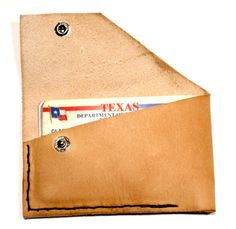 Thin, Simple. Men's Leather Wallet. Natural in color w/ White Stitching.. $35,00, via Etsy.