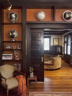 I love the orange backgrounds against the black built-ins. The door is great! Such a cozy space!  10 Beautiful Built-Ins and Shelving Design Ideas : Interior Remodeling : HGTV Remodels