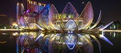 """Blooming out of an artificial lake at the center of Wujin, in China, is """"The Lotus Building"""" designed and built by Australian architecture f. Australian Architecture, Futuristic Architecture, Amazing Architecture, Architecture Design, Historic Architecture, Contemporary Architecture, Changzhou, Interesting Buildings, Amazing Buildings"""