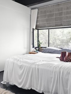 Contey's airy, unadorned bedroom is a prime spot for sunrise watching. Live / Work Space by Rick & Cindy Black Architects. Photo by Casey Dunn.