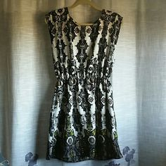 Aztec Pattered Silky Dress/Long Blouse Can be worn as a short dress depending on how tall y pou are or with leggings as a long blouse. Soft silky patterned material with a long back zipper for easy on and off. Worn 1 time and in superb condition. Dots Dresses
