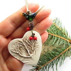 Heart ornament, ceramic Christmas tree ornament, woodland pine tree heirloom ornament. $28.00, via Etsy.