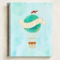 A perfect spot to jot down big thoughts, ideas and dreams. Design features a sky blue watercolor background and a gold, orange, and blue graphic of a hot air balloon that reminds us all to Dream Big