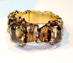 1960 1970 Wide citrine and gold bracelet | From a unique collection of vintage cuff bracelets at http://www.1stdibs.com/jewelry/bracelets/cuff-bracelets/