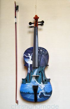 A violin with a ballet picture on