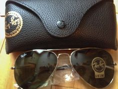 Color number: Model number: Currently one of the most iconic sunglass models in the world, Ray-Ban Aviator Classic sunglasses were originally designed for U. aviators in Lens Width Ray Ban Aviator, Ray Ban Sunglasses Sale, Sports Sunglasses, Sunglasses Case, Sunglasses For Your Face Shape, Spring 2015 Fashion, Mk Bags, Swagg, Bijoux