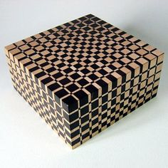 British boxmaker Martyn Brewer of Devon, UK employs a unique construction technique along with complex geometric patterns to create eye-popping boxes and cutting boards.