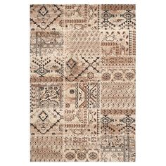 Inspired by traditional textiles, this loomed rug features a patchwork motif for a pop of exotic appeal.  Product: Rug