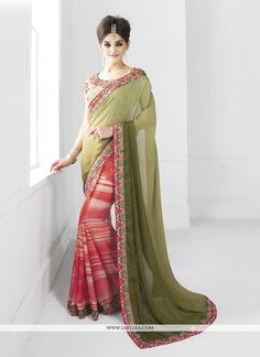 This delightful diva accoutre features unique styling and unusual material. Get the simplicity and grace with this multi colour faux chiffon classic designer saree. The lovely embroidered and patch bo...