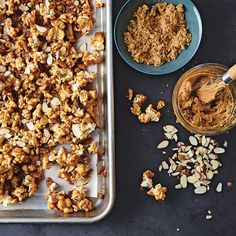 Here's a snack for those times when you want salt, sugar, fat, and crunch all in one bite. There's just enough butter to create a layer of caramel goodness. Peanut butter and sliced almonds provide...