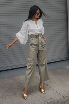 Paper bag plants are a true triple threat: Professional, trendy and figure-flattering. 31 Ways to Shake Up Your Style This May #purewow #shopping #street style #spring #outfitideas #fashion #shoppable #paperbagpants