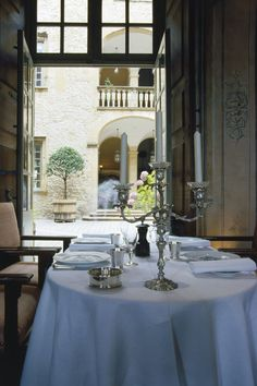 Situated in a cavernous, medieval space with monumental fireplaces, the restaurant combines impressive historical architecture with a Michelin star approach to cuisine nouvelle.