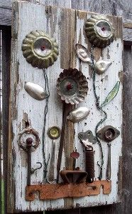 "Salvage Garden is an assemblage of reclaimed antique and vintage metal hardware, tins, wire and silver spoons mounted on old wood. This one of a kind original art measures 17 1/2"" x 11"" and comes ready to hang."