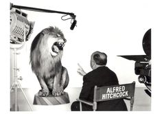 Alfred Hitchcock directing the MGM Lion, 1958. Photograph by Clarence Sinclair Bull