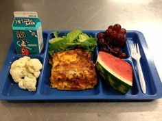 Lunch today at PPS Nutrition Services (Portland, OR) - lasagna, cauliflower, salad, grapes, watermelon and low-fat milk! Looks delicious!