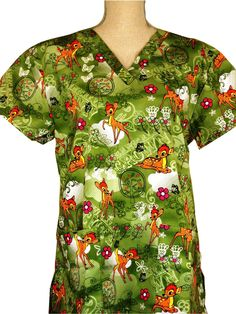scrub top - Bambi Green Organically Grown Theme - CaringPlus scrubs and uniforms - workwear clothing for nurses, caregivers and other healthcare professionals. Perfect apparel for doctor, dental and optician offices, nursing homes, rehab cent Interview Outfit Men, Medical Scrubs, Nurse Scrubs, Scrub Tops, Bambi, Work Wear, Fit Women, Floral Tops, Workwear Clothing