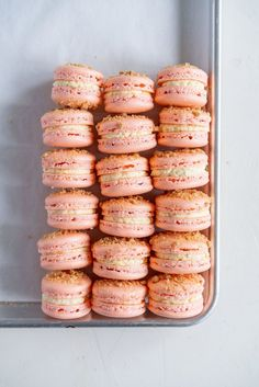 Roasted Peach Streusel Macarons - inspired by the peach cobbler, these french macarons have a roasted peach german buttercream, and a brown butter streusel crunch #macarons #peachcobbler #frenchmacaron #roastedpeach #germanbuttercream
