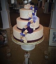 French Kiss Pastries | Purple flower Wedding Cake