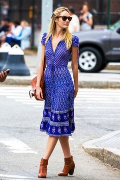 Candice Swanepoel wears a printed blue shirtdress with tan leather accessories
