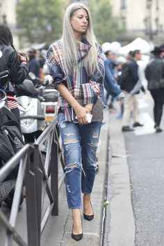 A pop of plaid and a little distressed denim were made for each other. | Très Chic! The Best Street Snaps at Paris Fashion Week | POPSUGAR Fashion