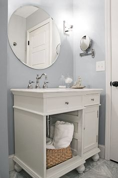 """See the 1960's-style drab """"before"""" of  this elegant gray-and-white bathroom, and apply the low-cost updates to your own! 