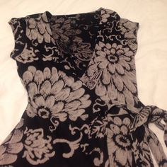 Lucky Wrap Dress Black & neutral tones.  Flattering wrap.  This is a true wrap dress that pulls through and ties around.  Excellent condition. Lucky Brand Dresses
