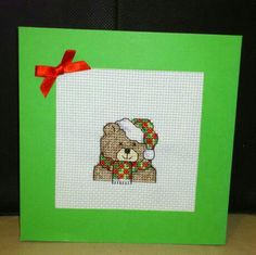 Christmas Teddy Card on green Christmas card   $2.50 each  Trifold card so stitching is covered.  Comes blank ready for your inscription.  Also comes with an envelope.  Facebook - Custom Cross Stitch Creations